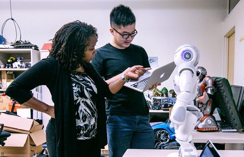 Dr. Ayanna Howard and graduate student, Jin Xu, setting up the NAO robot.
